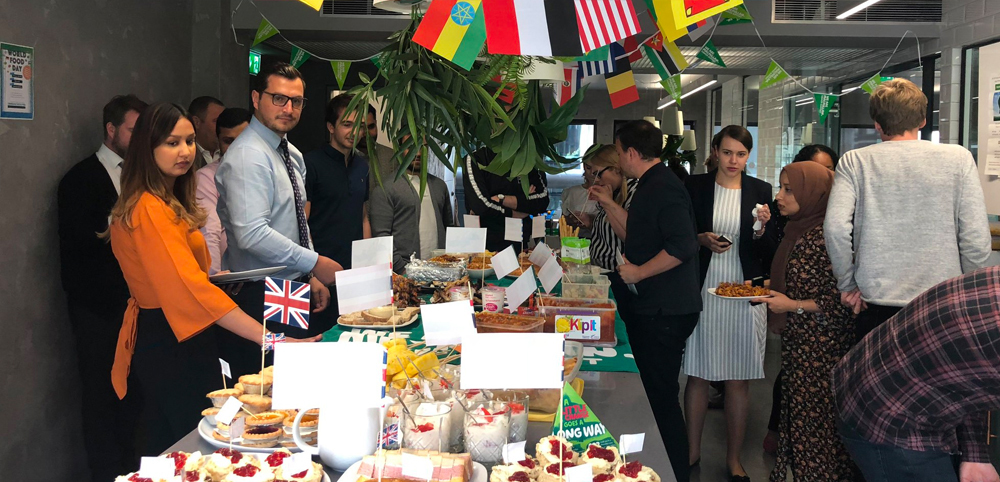 World Food Day at InterQuest Group's London office different food from different countries on a long table