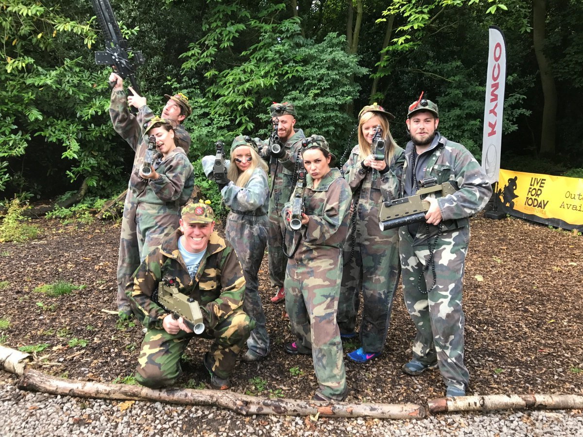 Photo of InterQuest Group's Tech North team at a paintball incentive