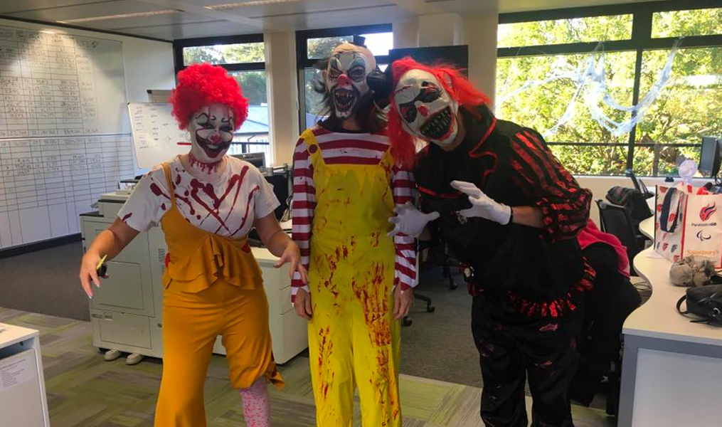 InterQuest Group colleagues dressed up in clown Halloween costumes