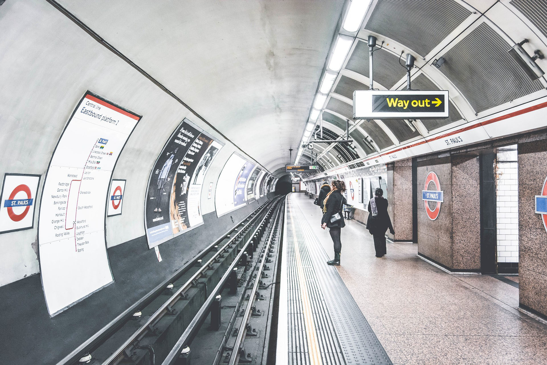 A photo of a London Underground platform taken at the edge looking down the tracks