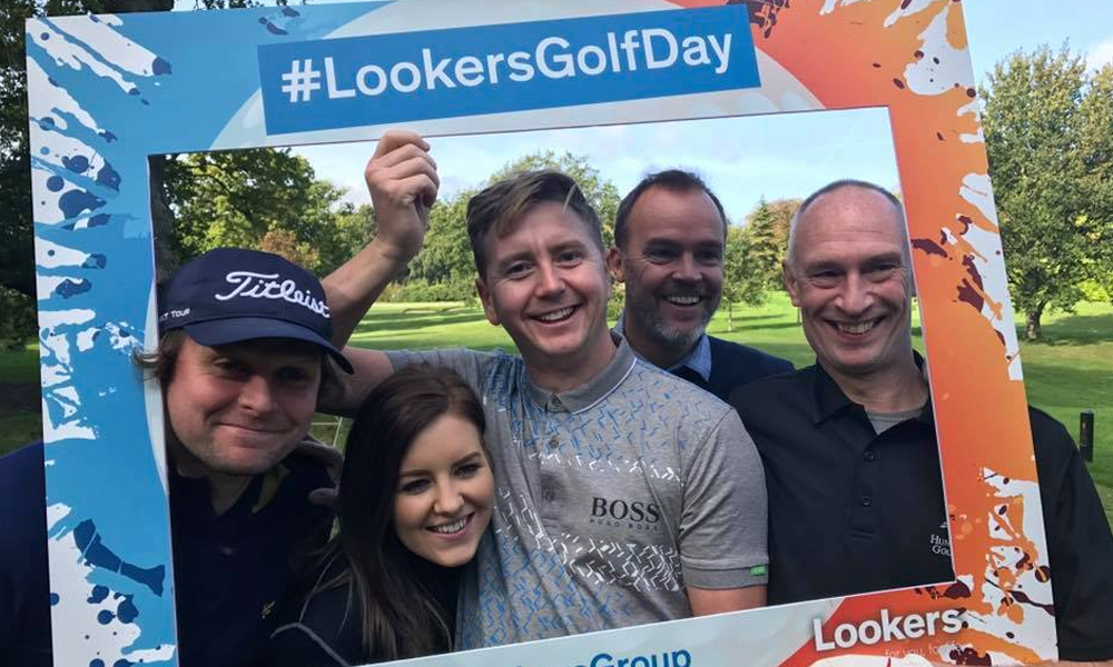 Five people on a golf course for Lookers Golf Day