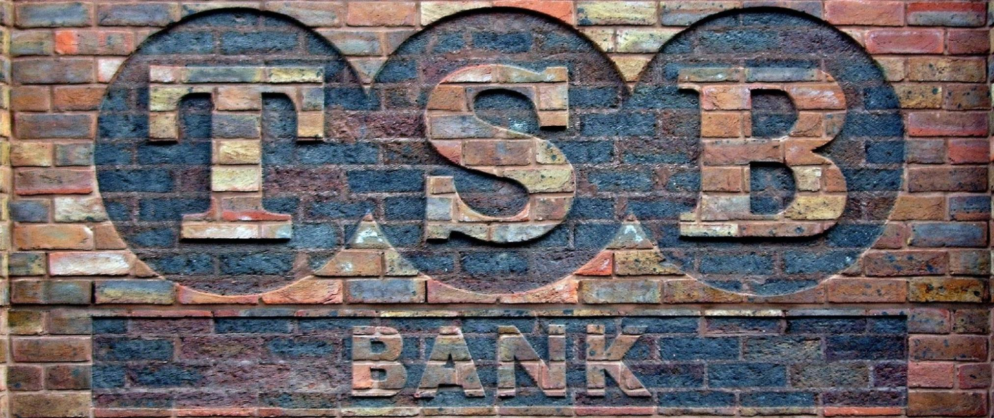 TSB Bank logo printed on a brick wall