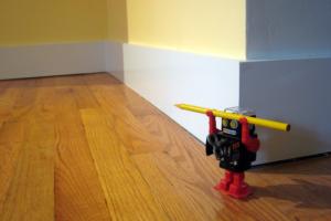 miniature robot holding a pencil