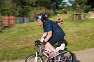 photograph of man on bmx bike going downhill